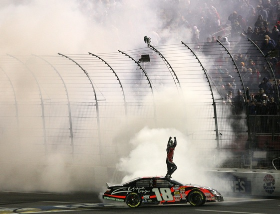 Kyle Busch celebrates his Nationwide victory at Lowe's Motor Speedway.  (Photo by Streeter Lecka/Getty Images)