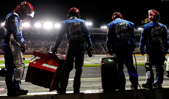 The pit crew of Juan Montoya waits on wall to attempt fixes on their driver's car.  (Photo by Rusty Jarrett/Getty Images for NASCAR)