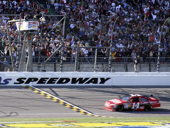 Tony Stewart takes the checkered flag during Sunday's Price Chopper 400 at Kansas Speedway. (RacinToday photo by Tony Bush)