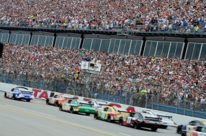 The cars run mighty close to the people at Talladega Superspeedway. (Photo by Rusty Jarrett/Getty Images for NASCAR)