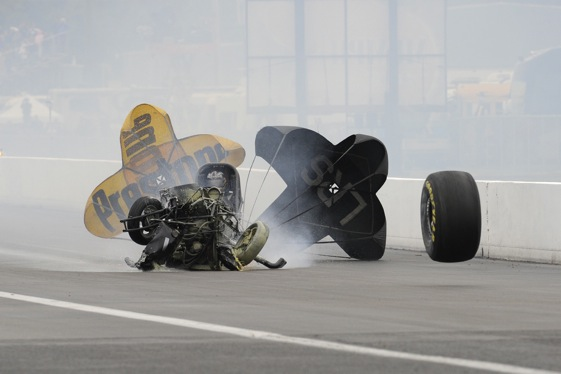 What remained of the Funny Car of Dan Wilkerson slides down the track at Memphis on Monday. (Photo courtesy of the NHRA)