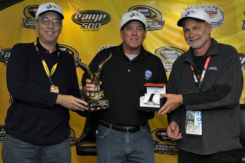 Camping World Truck Series driver Ron Hornaday Jr. is presented his trophy and Tissot watch by voting-panel member Lewis Franck, left, and Driver of the Year president Barry Schmoyer. (Photo courtesy of Brian Czobat/Autostock)