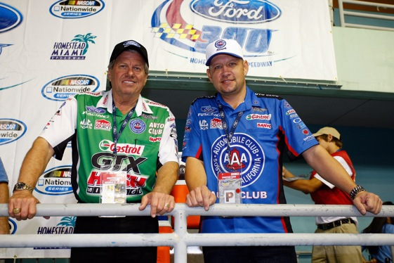 John Force and Robert Hight turned disaster into a championship in 2009. (Photo by Geoff Burke/Getty Images for NASCAR) 