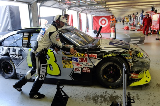 Chad Knaus pushes Jimmie Johnson's damaged car into the garages at Texas Motor Speedway on Sunday.  (Photo by Rusty Jarrett/Getty Images for NASCAR)