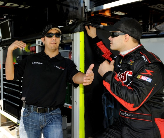 Matt Crafton, left, talks with David Gilliland in the garages at Texas Motor Speedway on Thurday. Crafton won the Camping World Truck Series pole.  (Photo by Rusty Jarrett/Getty Images for NASCAR)
