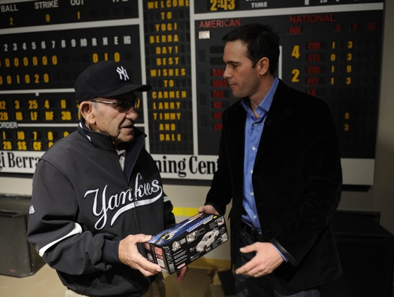 Jimmie Johnson, a four-time champion, gives 10-time champion Yogi Berra a new car during visit to New York on Monday. (Photo by Jeff Zelevansky/Getty Images for NASCAR)