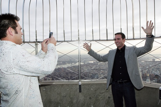 Jimmie gets his picture taken on Empire State Building by two-name athlete Johnny Damon of the Yankees. (Photo by Mike Stobe/Getty Images for NASCAR)