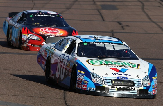 Sprint Cup driver Carl Edwards leads Sprint Cup driver Kevin Harvick during the Nationwide race at Phoenix a couple weeks ago. (File photo by Christian Petersen/Getty Images)