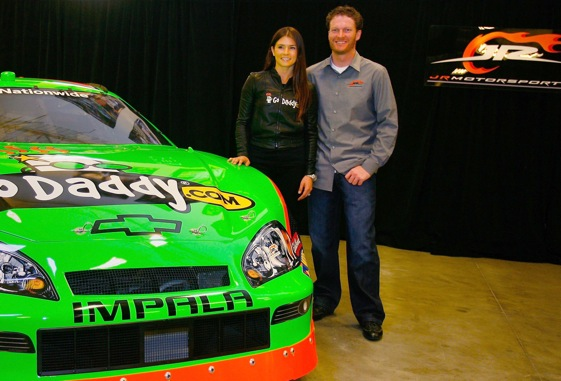 Dale Earnhardt Jr. and his new driver, Danica Patrick, did some posing on Thursday. (Photo by Jason Smith/Getty Images)