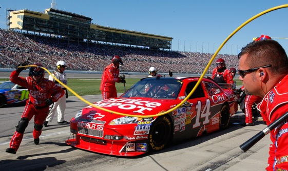Pit stops during the 2009 race at Kansas Speedway were conducted in front of packed grandstands. Can Kansas fill the place twice a year? It appears they will find out. (Photo by Geoff Burke/Getty Images for NASCAR)