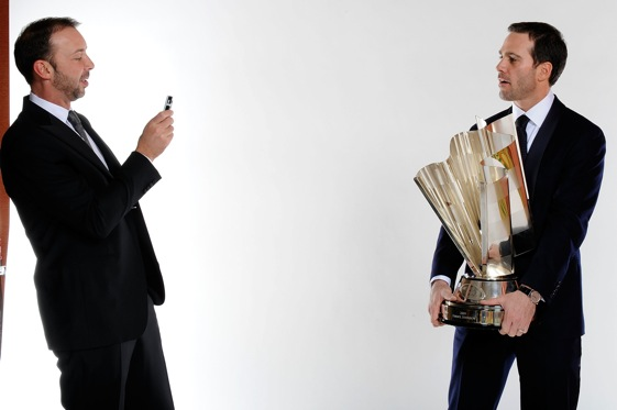 Chad Knaus snaps a couple photos of his driver, Jimmie Johnson, and the Sprint Cup trophy. (Photo by Rusty Jarrett/Getty Images for NASCAR)