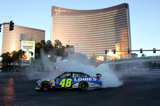 Jimmie Johnson does a burnout for the fans in Las Vegas on Thursday. (Photo by Todd Warshaw/Getty Images for NASCAR)