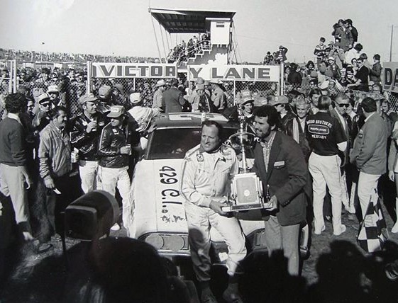 A.J. Foyt, driving for the Wood Brothers, accepts winning trophy at Daytona. (Photo courtesy of Wood Brothers Racing)