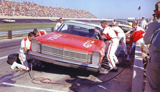 The Wood Brothers go to work on the car of Curtis Turner during a pit stop at Rockingham. (Photo courtesy of Wood Brothers Racing)
