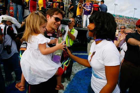 Jeff Gordon holds his daughter, Ella Sophia, as they talk with actress Anika Noni Rose. Awwww. (Photo by Jason Smith/Getty Images for NASCAR)