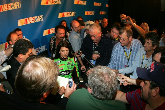 "You have got to give Danica Patrick an ""A"" for ability to attract a crowd. (Photo by Todd Warshaw/Getty Images for NASCAR)"