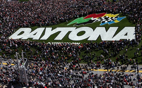 Fans crowded the infield grass for pre-race ceremonies at Daytona on Sunday. V