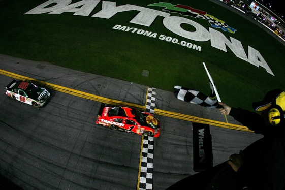 Missouri driver Jamie McMurray hits the finish line to win Sunday's Daytona 500.  (Photo by Todd Warshaw/Getty Images for NASCAR)