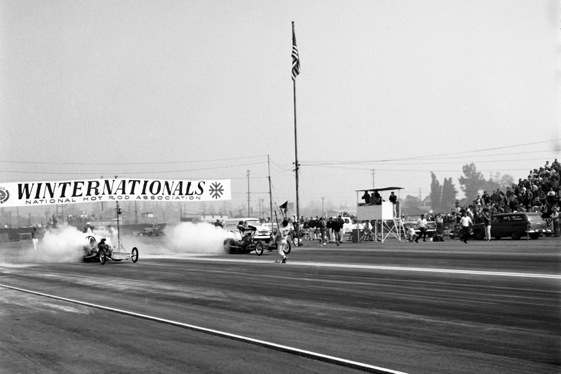 Don Garlits, in the right lane, experiences engine problem at Pomona. (Photo courtesy of the Full Throttle NHRA Drag Racing Series)