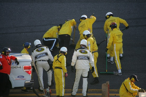 Work crews work to repair damage to the Daytona International Speedway surface.  (Photo by Jerry Markland/Getty Images for NASCAR)