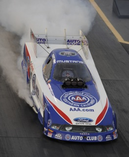 Robert Hight lights up the tires at Pomona on Thursday. (Photo courtesy of the NHRA)