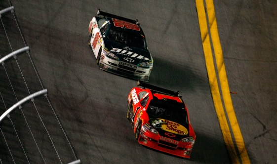 Jamie McMurray manages to stay ahead of Dale Earnhardt Jr. on the final lap of Sunday's 500.  (Photo by Jonathan Ferrey/Getty Images for NASCAR)