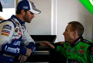 Jimmie Johnson and Mark Martin chat the old fashion way in garages on Wednesday. (Photo by Jonathan Ferrey/Getty Images for NASCAR)