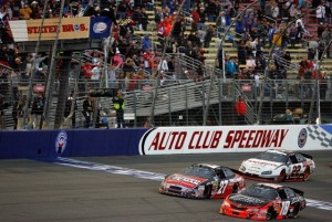 Kyle Busch nips Greg Biffle at the finish line to win Saturday&#039;s Stater Bros. 300 Nationwide race. (Photo by Tom Pennington/Getty Images for NASCAR)