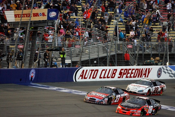 Kyle Busch nips Greg Biffle at the finish line to win Saturday's Stater Bros. 300 Nationwide race. (Photo by Tom Pennington/Getty Images for NASCAR)