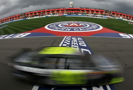Jimmie Johnson crosses the finish line at Auto Club Speedway on Sunday. (Photo by Jeff Gross/Getty Images)