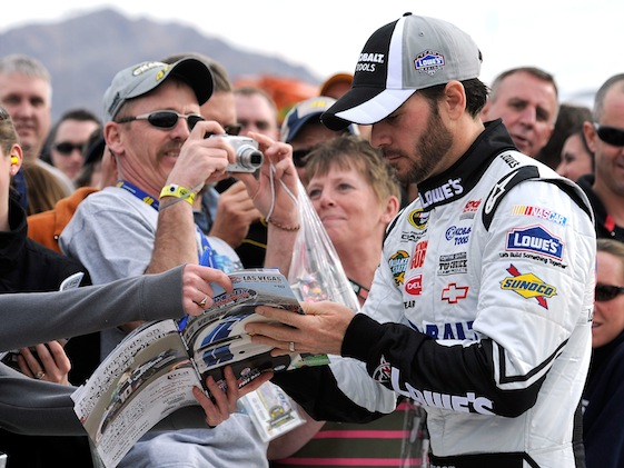 Jimmie Johnson signed autographs before Sunday's race in Las Vegas and then picked up the trophy afterward. (Photo courtesy of NASCAR)
