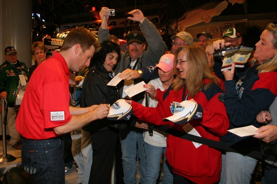 Jamie McMurray got in a few last autograph signings before heading west this week. (Photo courtesy of NASCAR)