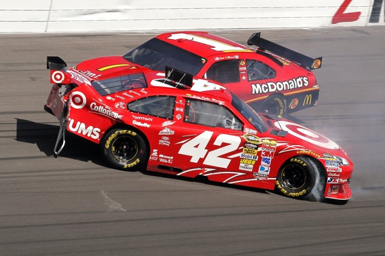 Jamie McMurray t-bones teammate Juan Pablo Montoya at Las Vegas. (Photo by Stephen Dunn/Getty Images for NASCAR)