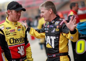 Jeff Burton, right, talks with teammate Clint Bowyer at a recent race. This morning at Watkins Glen, Burton took a big swing at safety at Pocono. (Photo by Tom Pennington/Getty Images for NASCAR)