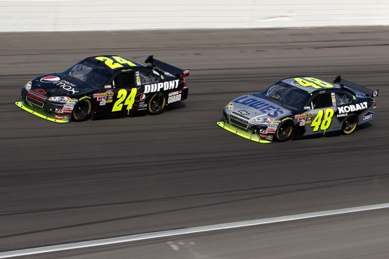 The competition between teammates Jeff Gordon and Jimmie Johnson is heating up and not just on the race track.  (Photo by Stephen Dunn/Getty Images for NASCAR)