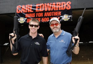 Last year, Carl Edwards and Texas Motor Speedway president Eddie Gossage's shot guns together to sell tickets. This year, Edwards is again helping TMS sell tickets. (Getty Images/Tom Pennington)