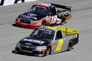 Kevin Harvick leads Kyle Busch during Saturday's truck race at Atlanta Motor Speedway. (Photo by John Harrelson/Getty Images)