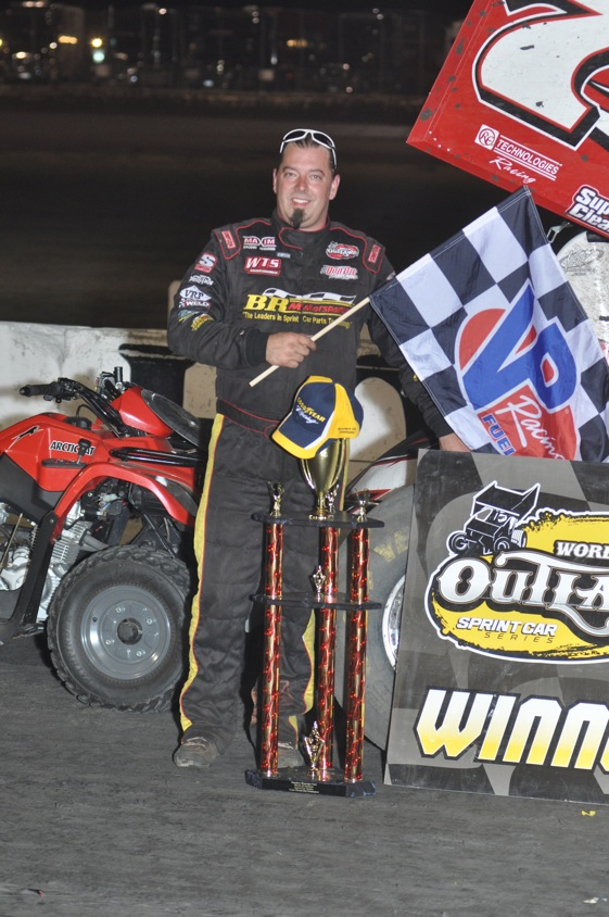 Jason Sides celebrates his win. (World of Outlaws photo by Boyd Adams)