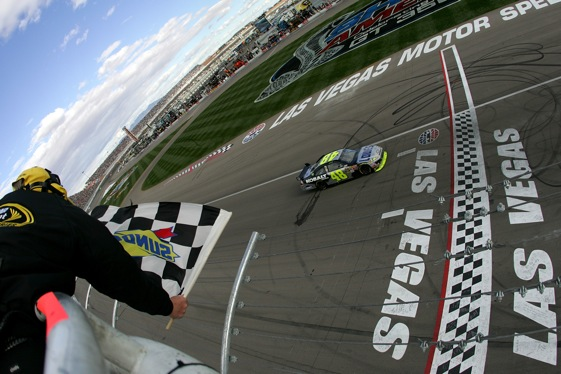 Jimmie Johnson takes a lot of checkered flags. Does he take too many? (Photo by Todd Warshaw/Getty Images)