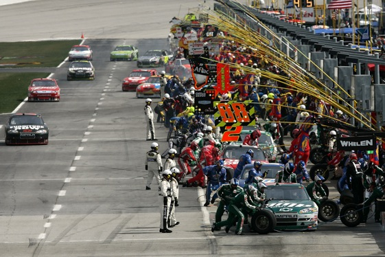 Crews go to work on the cars during Sunday's Kobalt 500 at Atlanta Motor Speedway. (Photo by Chris Trotman/Getty Images)