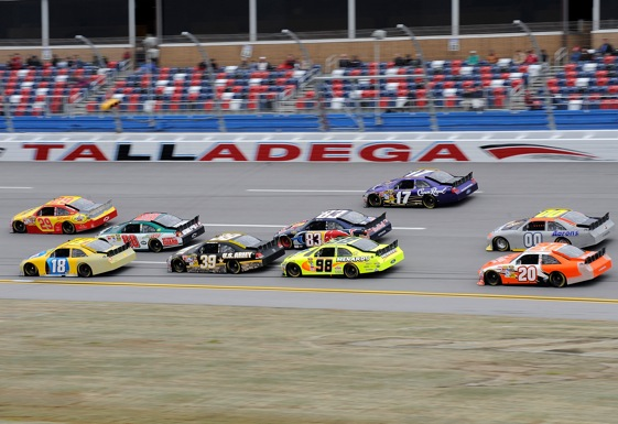 A pack of cars with spoilers tests the high banks at Talladega on Tuesday. (Photo by Rusty Jarrett/Getty Images for NASCAR)