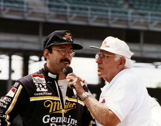 The late Tom Carnegie interviews Bobby Rahal, winner of the 1986 Indy 500. (Photo courtesy of Indianapolis Motor Speedway)