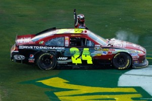 Jeff Gordon pops out of his car after winning at Phoenix this year. How many more? (Photo by Todd Warshaw/Getty Images for NASCAR)