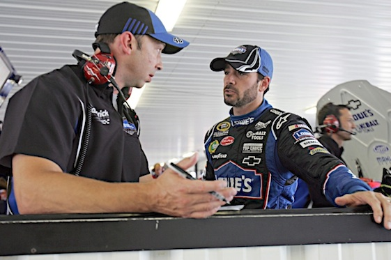 Chad Knaus and Jimmie Johnson talk racing in garages at Pocono onday. (RacinToday/HHP photo by Alan Marler)