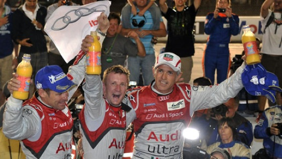 Audi drivers celebrate in Victory Lane after winning the Sebring 12-hour race in 2012. (Photo courtesy of the American Le Mans Series)