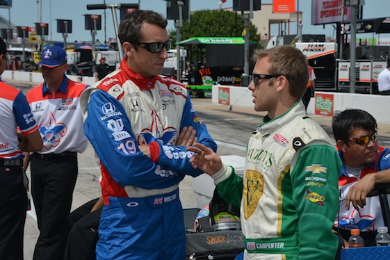 Justin Wilson and Ed Carpenter in the pits at Texas in 2013. (Photo courtesy of the IZOD IndyCar Series)