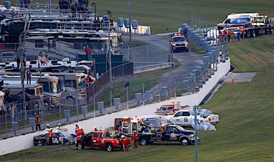 Rescue personnel surround the site where Kyle Busch was injured at Daytona International Speedway. (RacinToday/HHP file photo by Tom Copeland)