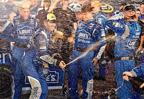 It was a familiar scene in Victory Lane at Texas Motor Speedway on Saturday night: Jimmie Johnson and his crew celebrating a Sprint Cup win in Fort Worth. (RacinToday/HHP photo by Andrew Coppley)