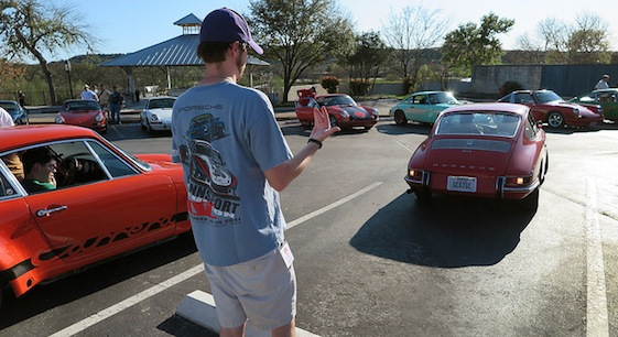Care is taken while backing a vintage 911 into a parking spot in Texas.