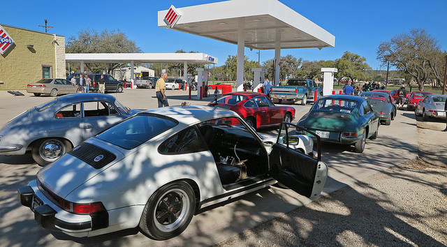 Thirsty Porsches line up for drinks.